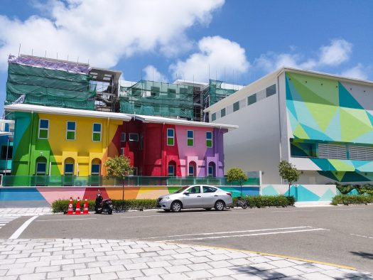 K in Motion Travel Blog. Travelling the Maldives on a Budget. Hulhumale Colourful Building With Construction Behind