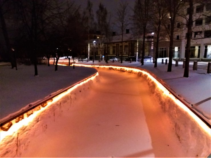 K in Motion Travel Blog. Chasing the Aurora Borealis in Finnish Lapland. Lights on Canal Bank