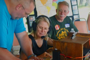 Delegate Brenda Pogge makes contact during ARRL Field Day 2010 with the help of Dave NM4M.