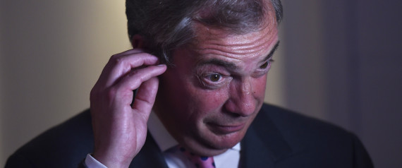 Nigel Farage, the leader of the United Kingdom Independence Party (UKIP), struggles with a television ear piece as he gives interviews at a Leave.eu party after polling stations closed in the Referendum on the European Union in London, Britain, June 23, 2016.  REUTERS/Toby Melville
