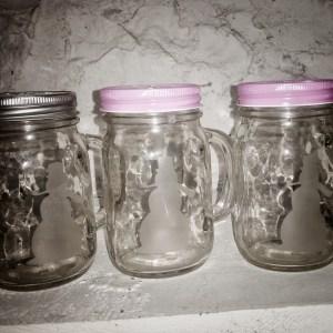 Etched snowman mason jar mugs with handles.