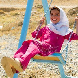 Afghan girl on swing.