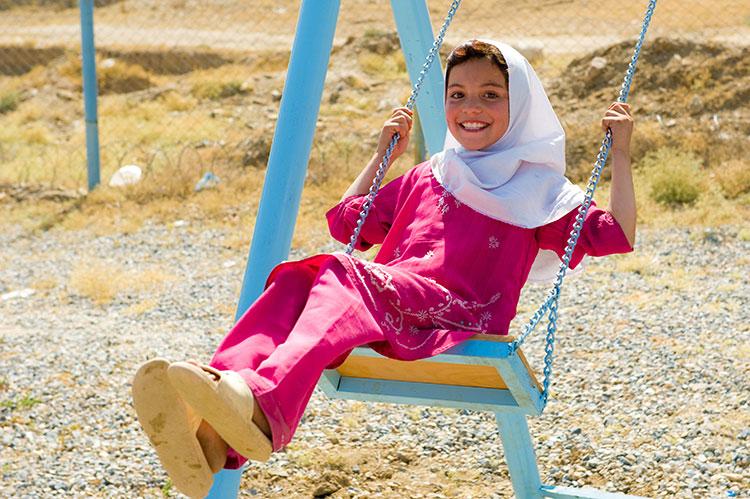 Afghan girl on swing.