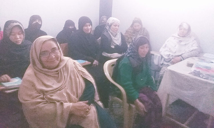 Afghan female students sitting in class.