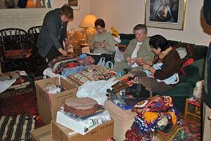 Volunteers sorting auction items.