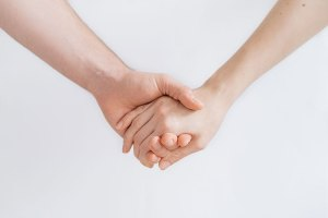 Two hands holding each other.