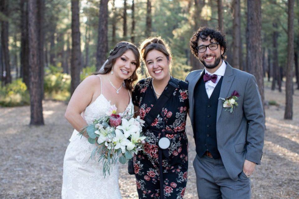 Kaci Lou with a wedding couple. Outdoor forest wedding photographer in Flagstaff Arizona