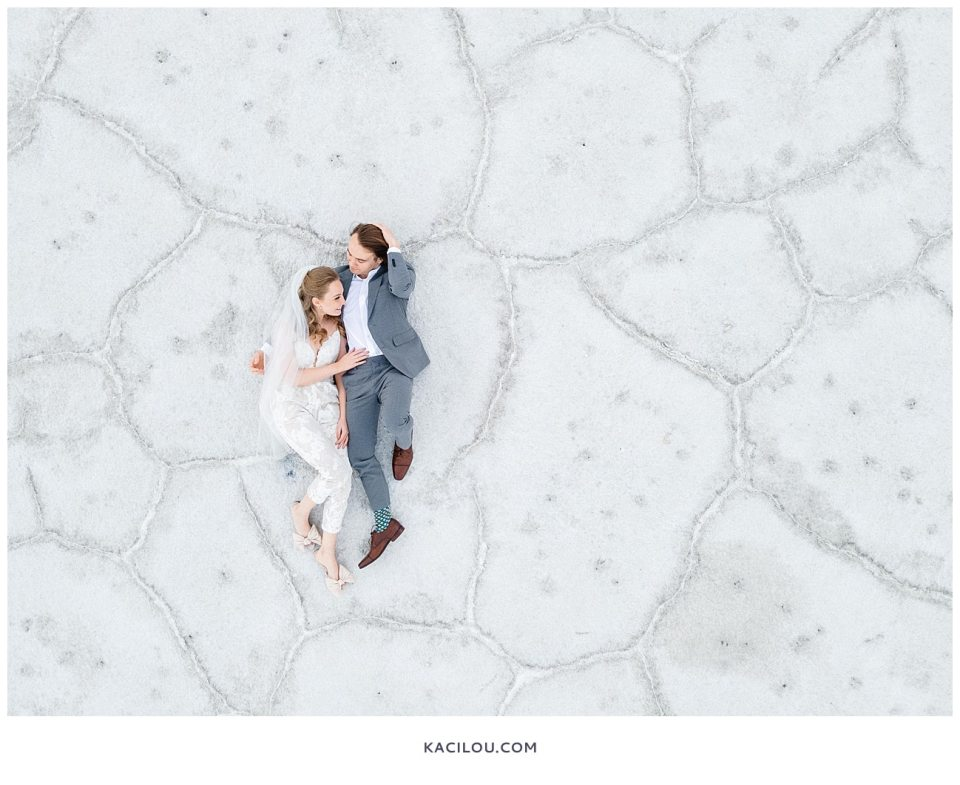 bride and groom photo from above at salt flats so you can see line