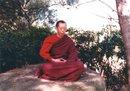Geshe-la meditating on a rock