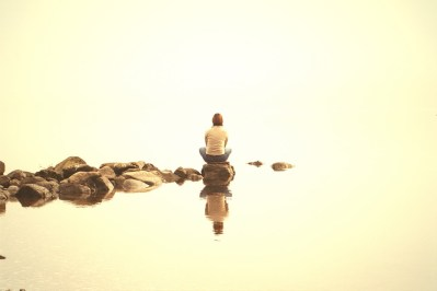 meditating on rock