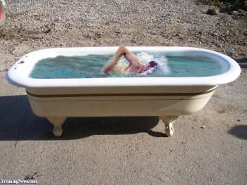 swimming in bathtub