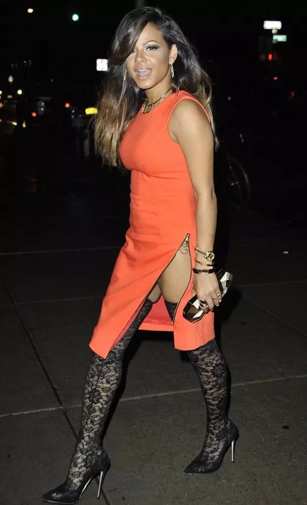 Christina-Milians-Watch-What-Happens-Live-Milly-Orange-Asymmetrical-Side-Slit-Zip-Cady-Sheath-Dress-and-Dolce-Gabbana-Lace-Thigh-High-Boots