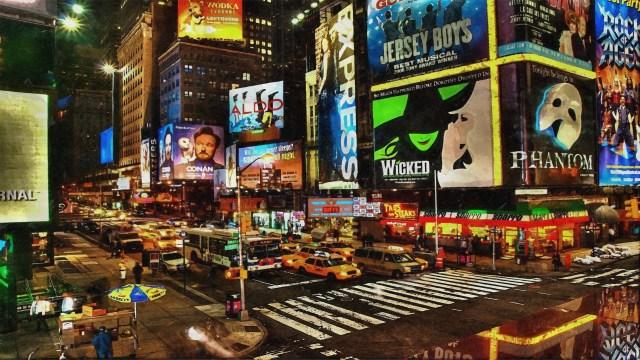 ภาพของถนนยามค่ำคืนที่คราคร่ำไปด้วยรถยนต์และผู้คน