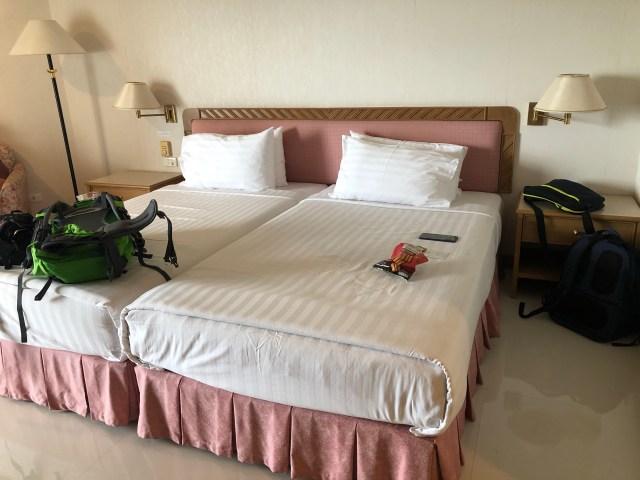 เตียงในห้องพักแบบ Deluxe เตียงเดี่ยวสองเตียง