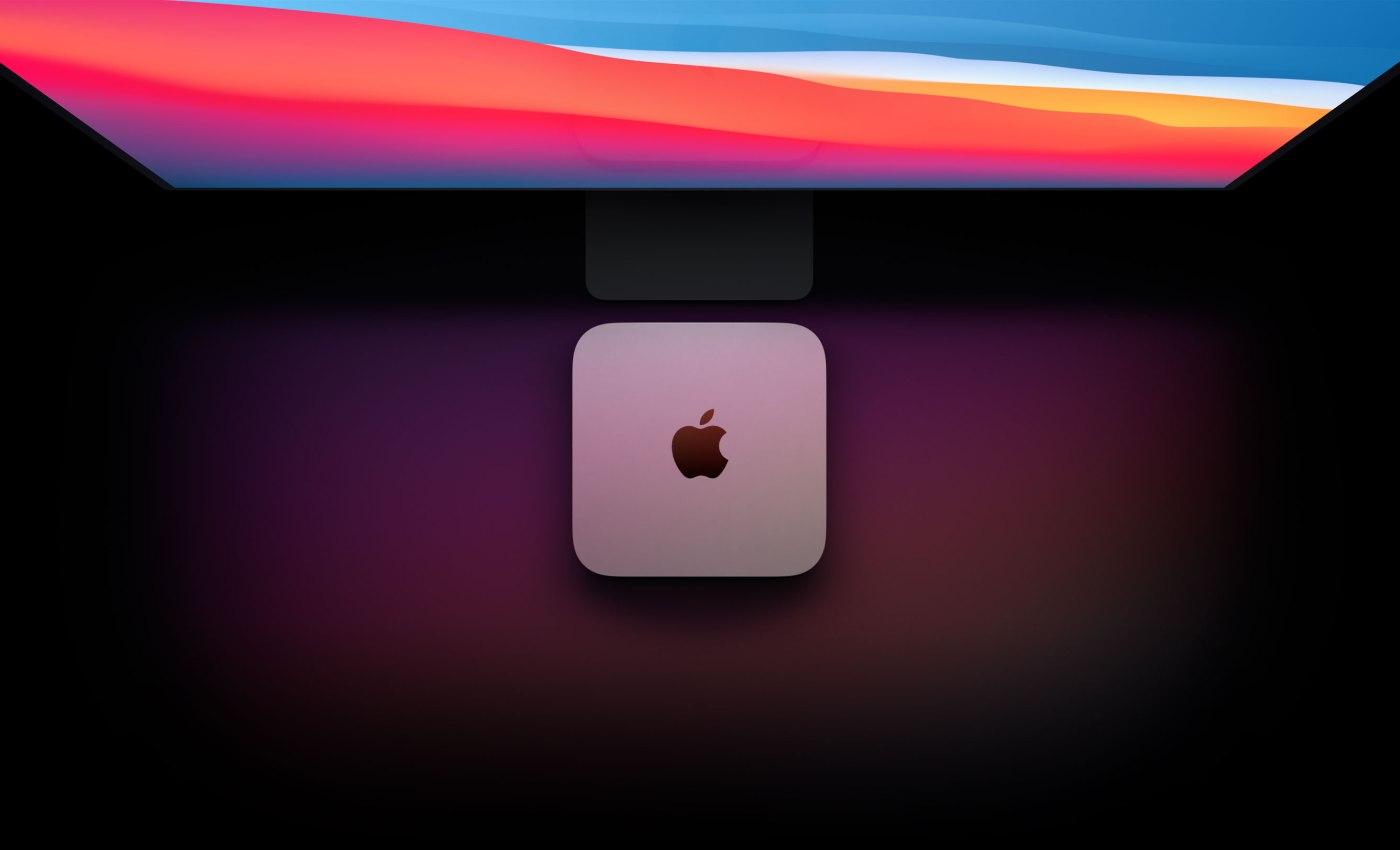 ภาพด้านบนของ Mac mini รุ่นชิป Apple M1 จากด้านบน ซึ่งวางอยู่บนหน้าจอคอมพิวเตอร์ขนาดใหญ่