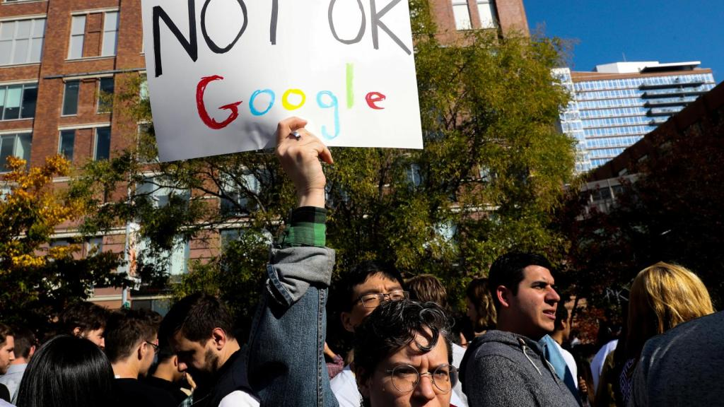 "A protester holding a sign reading ""Not Ok Google"""