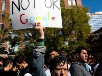 """A protester holding a sign reading """"Not Ok Google"""""""