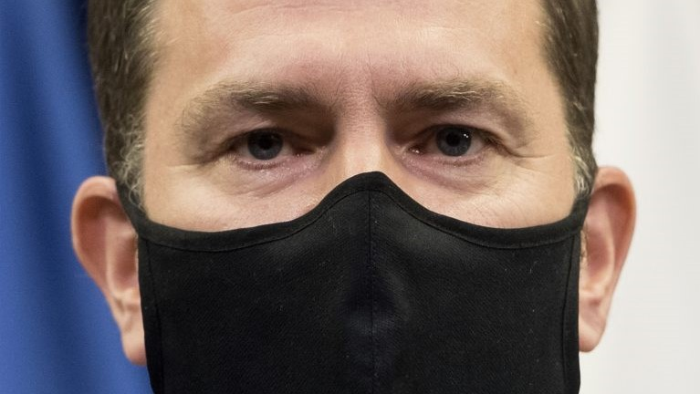Slovak Prime Minister Igor Matovic wearing a black-face-mask