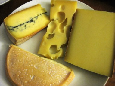 From Top Left to center middle: Morbier with the green veins, Gruyère, Comté, and Rebluchon, I think.