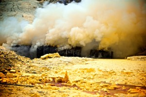 Sulphur smoke at an Indonesia mine. Photo by Andy VC. Source: www.andyvc.com/sulfur-miners/