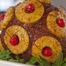 Classic American holiday ham with cocktail cherries and brown sugar, spice, clove glaze. Photo source: desktopcookbook.com
