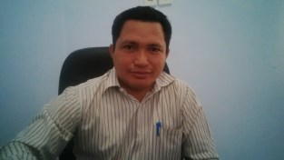 Komisioner KPU Kabupaten Bima. M. Waru, SH. Foto: Bin