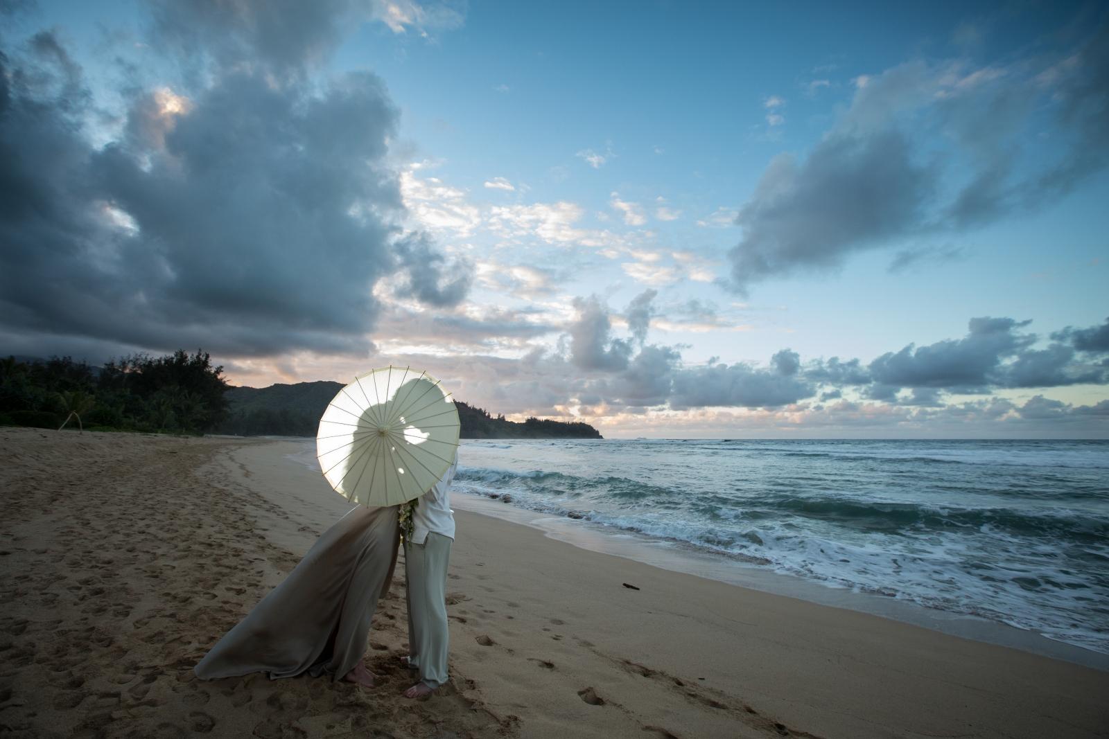 Sunset wedding shoot with backlighting and umbrellas!