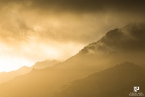 Mist settles in the saddle between Mt. Wai'ale'ale and Makaleha to hide her mysterious features from prying eyes