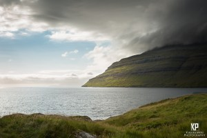 A storm builds over the mountains in the Faroe Islands contrasting the calm and the chaotic