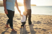 Family Walking on the beach during a gorgeous Kauai Sunset