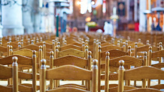 Empty seats in a church.