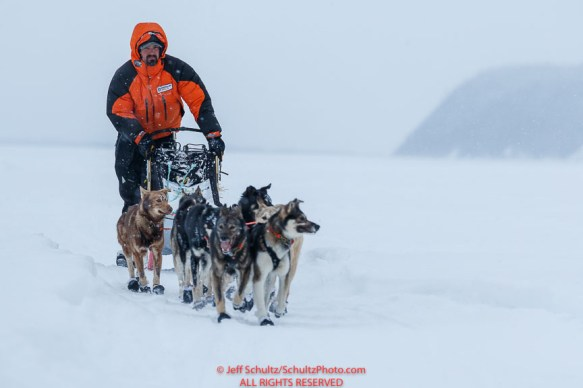 Pete Kaiser runs on the Yukon River as we makes his way to be the first to the Kaltag checkpoint on Saturday March 9th during the 2019 Iditarod Trail Sled Dog Race. Photo by Jeff Schultz/ (C) 2019 ALL RIGHTS RESERVED