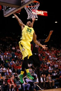 Oregon's Carlos Emory slam-dunks the ball in front of Utah's Dakarai Tucker during a Pac-12 Tournament semifinal game at the MGM Grand Garden Arena in Las Vegas on Friday, March 15, 2013. (Kai Casey/CU Independent)