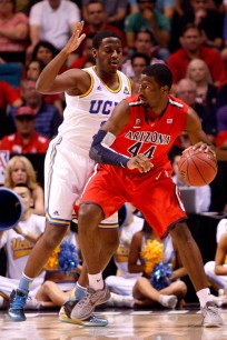 Arizona's Soloman Hill works against UCLA's Jordan Adams during a Pac-12 Tournament semifinal game at the MGM Grand Garden Arena in Las Vegas on Friday, March 15, 2013. (Kai Casey/CU Independent)