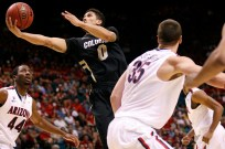 Askia Booker of Colorado attempts a layup between Soloman Hill (44) and Kaleb Tarczewski (35) of Arizona during a Pac-12 Tournament game at the MGM Grand Garden Arena in Las Vegas on Thursday, March 14, 2013. (Kai Casey/CU Independent)