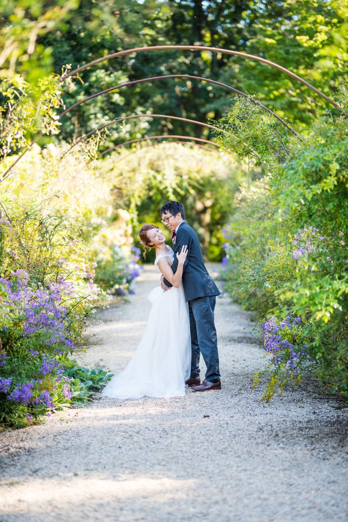bride and groom laughing under metal arbor Kaitlyn Ferris photography garden wedding