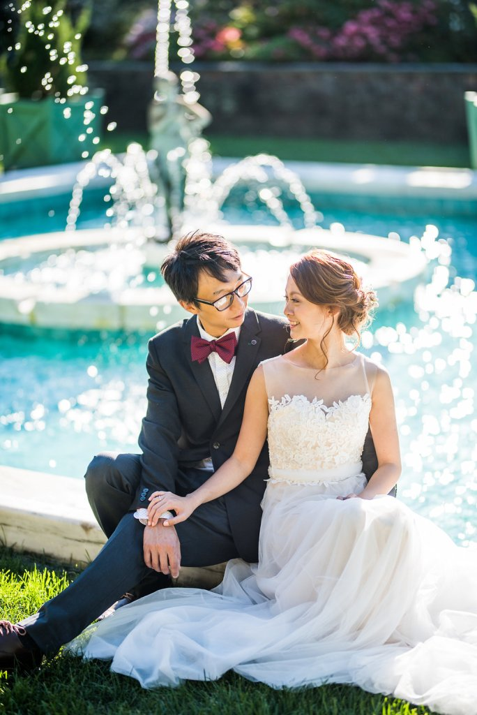 bride and groom by a fountain Kaitlyn Ferris photography garden wedding