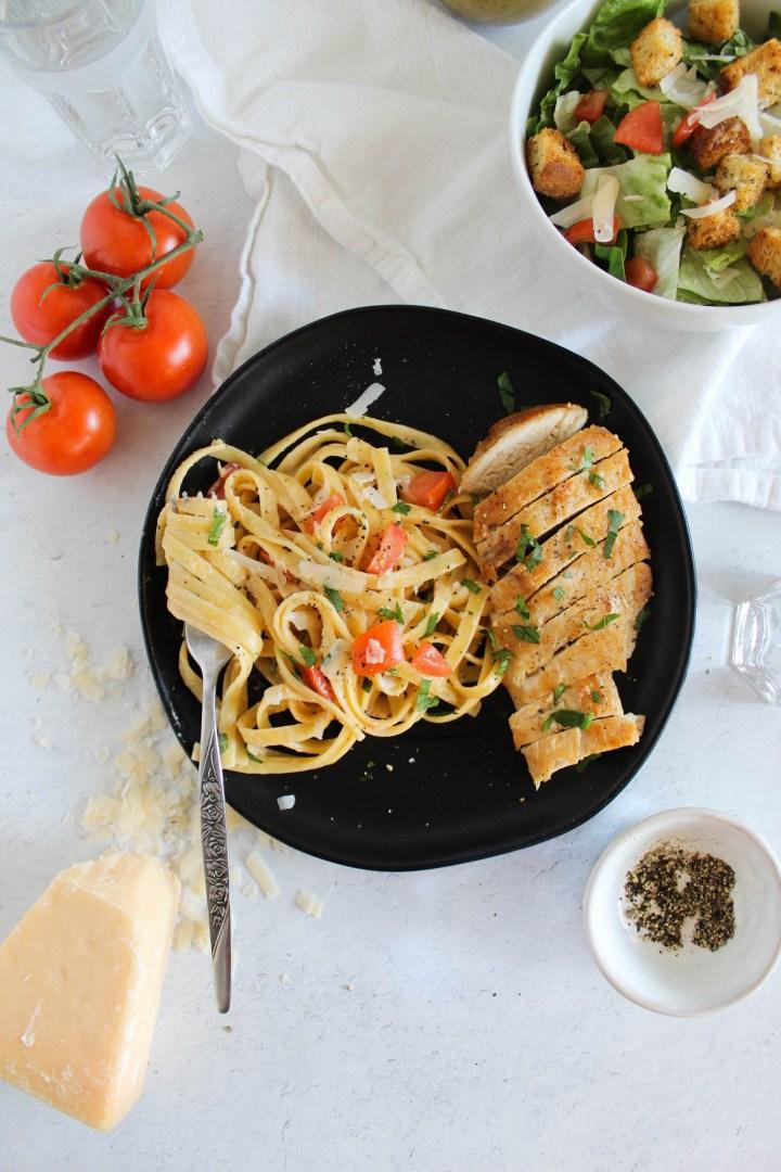 healthier cajun chicken pasta wrapped around a fork.