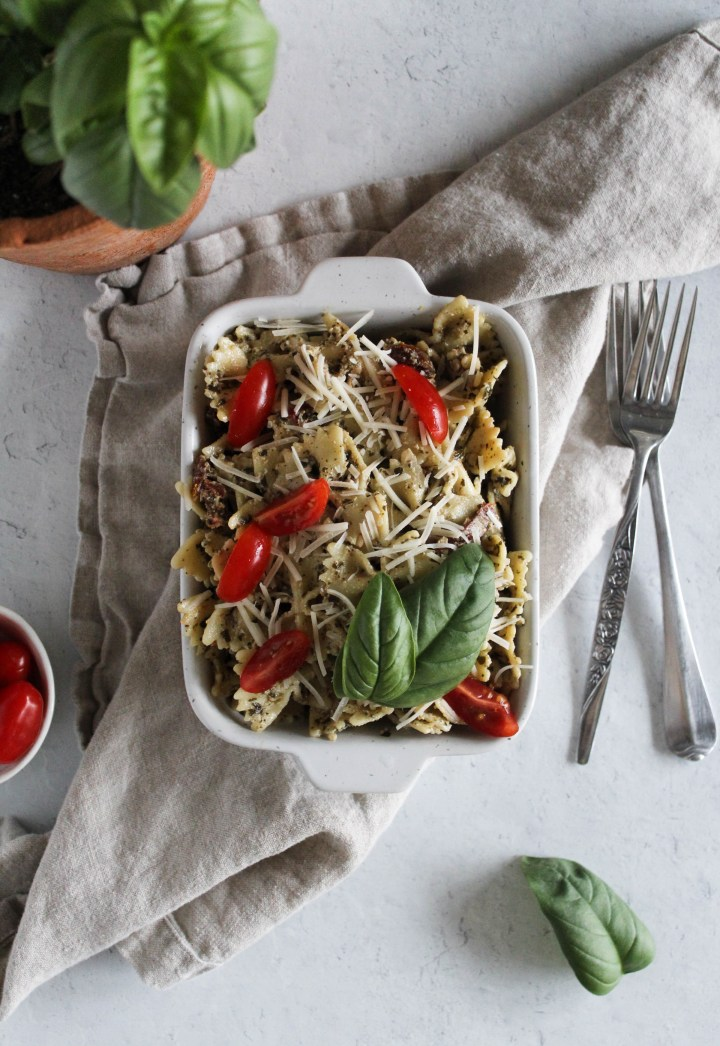 Overhead view of pesto pasta in a baking dish.