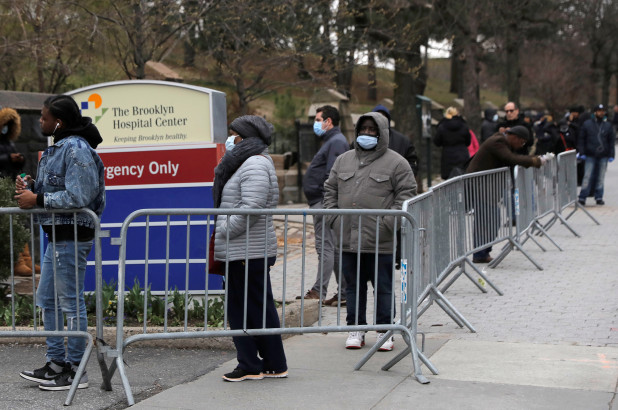 BELOW: People wait to enter a tent erected to test for the coronavirus disease at the Brooklyn Hospital Center in Brooklyn Saturday morning. Photo - Reuters.