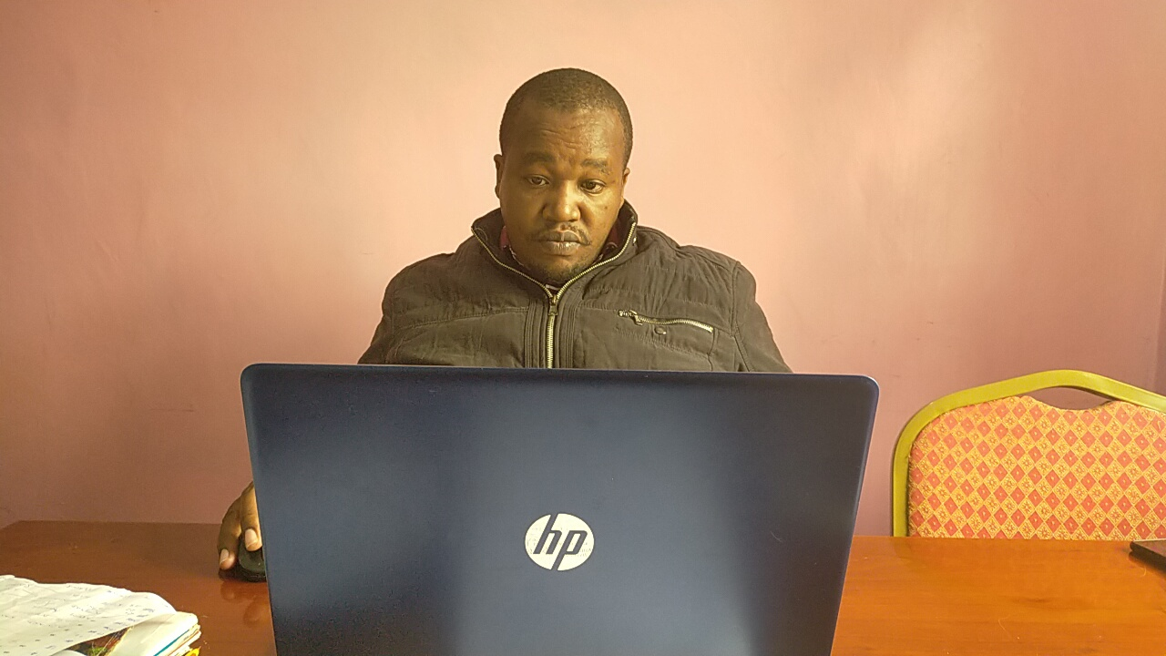 Wambugu wa Kamau at work on zoom session.
