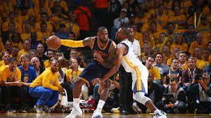 James guarded by Iguoadala, MVP of the NBA Finals 2014
