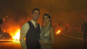 wedding couple posing in front of a riot