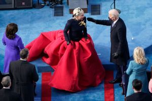 Lady Gaga in giant flared skirt talks to new President Biden