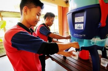 Students of SMK Sepulut in Sabah having their first drink of clean filtered water at their school.