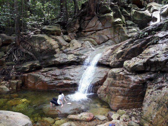 Take a relaxing dip at one of the waterfalls at Mount Santubong.