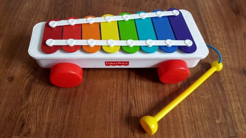 Cymbalki ksylofon na kółkach pierwsze zabawki malucha Fisher Price 1