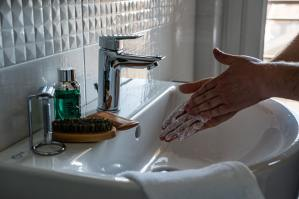 Washing Hands with the faucet turned off is an easy way to save water.