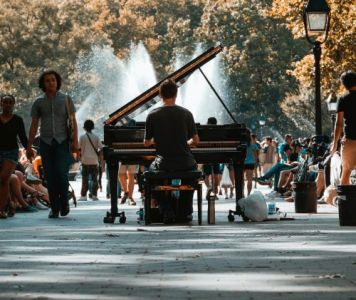 A Piano Player Busking in the Park. Image by Josh Appel.