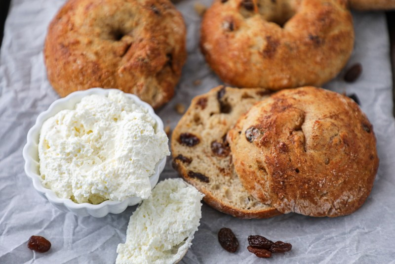 An easy bagel recipe made with simple ingredients and no boiling required! They're super soft and full of raisins and cinnamon!